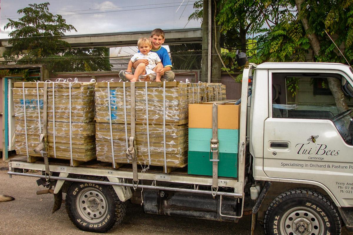 Boy Sitting on Honey Truck